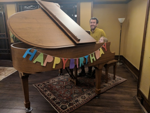 Iola's fifth birthday present, a piano!